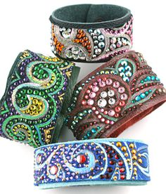 One-of-a-kind Swarovski crystal & hand painted leather bracelets from Caroline Rocha.