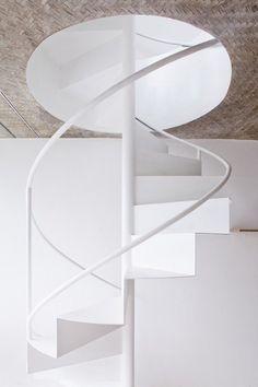 Textured ceiling. Spiral staircase. Design by Sanuki + Nishizawa architects. Photo by Hiroyuki Oki.