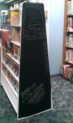 Chalkboard contact paper placed on the end of a bookshelf was an instant hit! Chalk was placed on a nearby table for use by the teens. #teen #programming #library #chalkboard