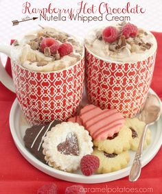Raspberry Hot Chocolate with Nutella Whipped Cream.  Share this with someone you love!