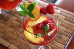 Basil, Peach and Raspberry Summer sangria is great for summer gatherings! Substitute lemonade and peach nectar to make this alcohol-free!