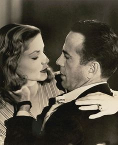 Humphrey Bogart and Lauren Bacall go for a kiss in To Have and Have Not (1944)