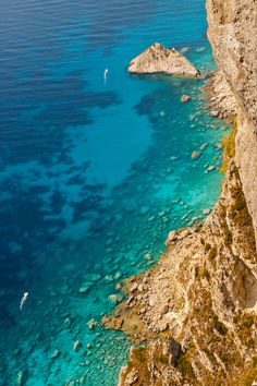 The amazing crystal clear water of the rocky shores of Corfu. View from Angelokastro fortress