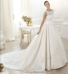 I don't normally like dresses like this, but this one is really pretty to me. Pronovias has the best wedding dresses.