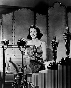 Vivien Leigh accepting her Oscar for her role as Scarlett O'Hara.