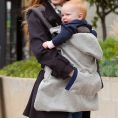 Hoodie All-Season - universal carrier cover that converts to fit most infant carriers, and includes a detachable, weather-shielding hood for baby and front cuddle pockets for mom!