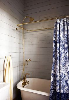 Step Inside the Ultimate Bayou Cottage | DomaineHome.com // Clawfoot tub with brass shower  ▇  #Home   #Bath #Decor