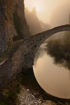 Single arched stone bridge of Kokkorou, Epirus, Greece #Greece -- Find articles on #Adventure #Travel , #Outdoor Pursuits, and #Extreme Sports at http://adventurebods.com or find us on http://facebook.com/adventurebods