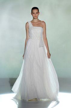 An asymmetric wedding gown from Rosa Clara. #WouldYouWearIt