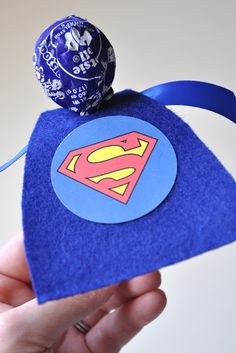 Great Idea for my favorite little super hero!  I bet it would work with black and the bat symbol. I put this under kid stuff, but my husband would love it! party favors, birthday parties, boy party, lollipop, comic books, superhero party, cake pops, super hero birthday, kid stuff