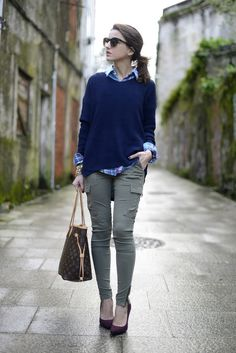 Slim cargo pants, oversized sweater over button-up shirt