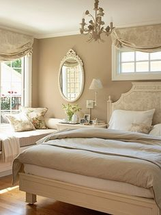 Neutral Oasis - A taupe and cream color palette creates a calming setting. Painting the chandelier and mirror frame a creamy shade helps the accents blend in with the decor. Beige bedding gives the room an easy elegance. To add interest, patterns were used sparingly -- toile covers the headboard and windows while floral throw pillows add spots of color to the room.
