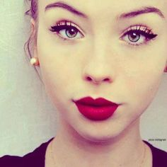 Red lips and winged liner