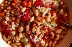 Satisfying Slow Cooker Pasta e Fagioli   a satisfying fall soup.  Creamy cannellini beans and pasta are cooked in a rich tomato broth speckled with carrots, celery and onions.  This is a great meal to make during the week because it doesn't require much preparation or tending over the stove top.  Serve pasta e fagioli with plenty of slices of crusty garlic bread.