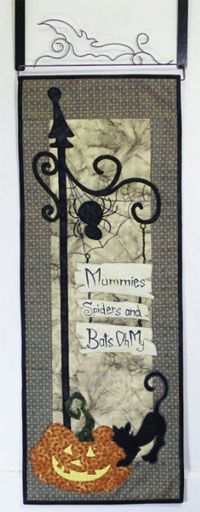 """Greetings For Ghoul Friends Wallhanging/Door Banner Pattern by Patchabilities at KayeWood.com.  Each finished mini quilt measures 12 x 32 inches. Change out the hanger each month with a 12 inch wide hanger. Hang them easily on a door with a set of """"over the door holders"""" and without putting nails in your door (husband approved).  http://www.kayewood.com/item/Greetings_For_Ghoul_Friends_Wallhanging_Door_Banner_Pattern/3478 9.00"""