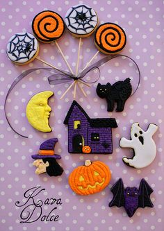 Festively fun orange, purple, black, yellow and white Halloween cutout cookies. #food #Halloween #cookies