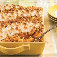Classic Sweet Potato Casserole | celebrate fall with a classic sweet potato filling topped with cornflakes, pecans, and gooey marshmallows. | SouthernLiving.com