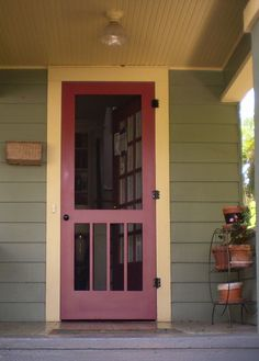 Green siding, yellow trim, red door