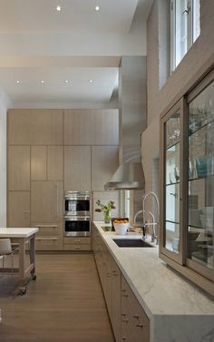 Modern kitchen: high ceilings; monochrome; waterfall counter