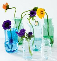 Recycled plastic bottle vases. I was looking for a great way to reuse plastic bottles...think i found it!