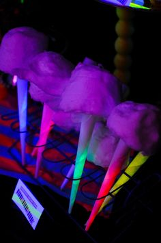 Love this illuminated cotton candy! Cool for carnival or circus theme parties. Stick a glow stick in the rolled paper part to re-create the look for cheap: http://www.flashingblinkylights.com/light-up-products/glow-sticks.html