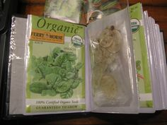 Organize seed packets and seeds in a photo album.