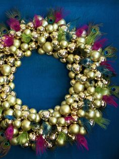 Gorgeous Wreath by HGTV's @Meg Caswell Holladay Love the peacock feathers! http://www.hgtv.com/decorating-basics/celebrity-holiday-homes-peek-inside-festive-star-studded-spaces/pictures/page-72.html?soc=pinterest