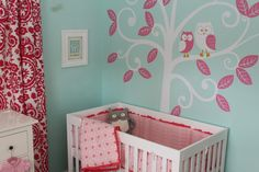 Aqua and pink nursery with bold prints and accents. #aqua #pink #baby #nursery