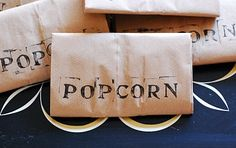 Make your own microwave popcorn.  via Dollar Store Crafts