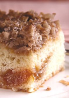 Apricot Crumble Cake — Apricot preserves are baked inside this delicious dessert recipe. After baking, the warm cake is spread with a cinnamon-coconut crumble and broiled until golden.