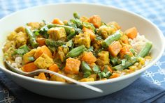 Tempeh Curry with Sweet Potatoes and Green Beans // Tempeh absorbs the rich spices and coconut milk in this simple curry. Cook the rice and steam the tempeh while prepping your other ingredients and it will come together quickly.
