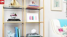 Jana Bek loves the brass boats on the top shelf of this bookcase.