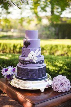 purple wedding cake // photo by Ashley Biess, event design by La Belle Fleur Events http://ruffledblog.com/parisian-gothic-wedding-inspiration