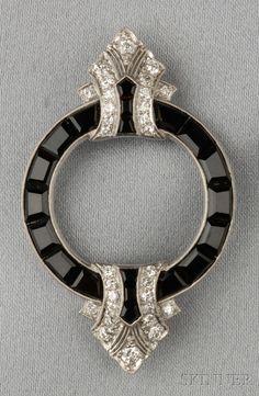 Art Deco Platinum, Onyx, and Diamond Brooch, set with fancy-cut black onyx, old European-cut diamond accents, millegrain details, no. 3044, lg. 2 in., maker's mark.