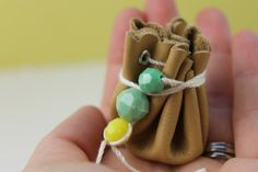 Tiny Leather Pouch - Forget gift boxes! This tiny DIY pouch is easy to make and perfect for little gifts like rings and earrings.