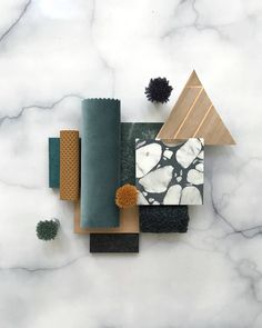 Teals, tans and the deepest navy verging on black. A mixture of our velvet, textiles, embossed leather, Ecoustic Blade and Facet wallcovering with amazing Vulcano Design terrazzo from Perini Tiles. Green, teal, beige, gold, black, blue and oak timber combination for this interiors flatlay moodboard.