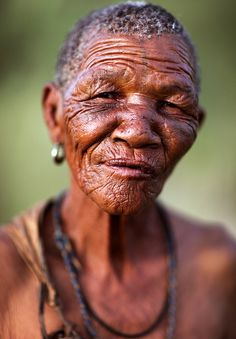 An old African woman from the Bushmen tribe in Botswana, Kalahari Desert.