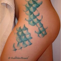 Mermaid tattoo...fish scales this would be so cool. but i would put it a little lower in my thigh.