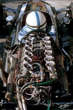 1965 World Champion John Surtees sits in front of a Maserati 9/F1 engine in his Cooper T86. Surtees had switch to Cooper midseason after quitting Ferrari after being left off the drivers' roster for Le Mans. The Cooper managed two victories with the heavy, underpowered engine whose design dated back to the 1950s.