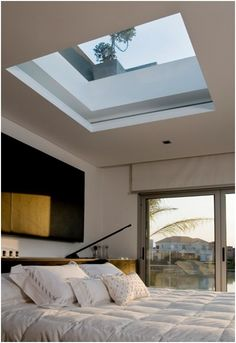 Above bed oversized skylight- I would love looking up at the stars every night and the rain/thunderstorms would be amazing. add a remote-controlled shade for morning and it would be perfect.