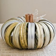 Don't toss those canning jar rings - sting 'em together to make this adorable fall pumpkin!