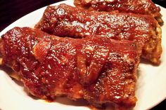 Lazy BBQ Ribs: they take almost no work, bake in your oven, and will fall right off the bone.