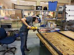 Team member Kara Morgan works on our rocket test stand.
