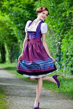 An absolutely lovely red, blue and purple lace-up front dirndl dress. #dirndl #dress #folk #costume #German #clothing