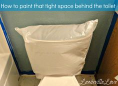 Lewisville Love: Painting that Pesky (tight) area behind the toilet. Use a plastic bag - put paint on it then slide behind the toilet and press with your hand. Great idea.