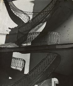 Bill Brandt (1904-1983) - Bombed Regency Staircase, Upper Brook Street, Mayfair, ca 1942 Gelatin silver print (22.8 x 19.4 cm) The Muse...