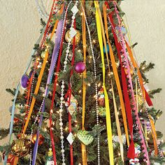 Christmas Decorating Ideas: Tree Ribbons from Southern Living.  I love the ribbon idea--it looks old fashioned.