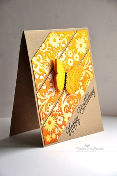 handmade birthday card ... yellow die cut butterfly ... kraft base ... emboss resist and Distress Inks in orange and yellow ... bands of colored texture running diagonally across the card ... great card!!