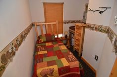 One of two bedrooms - http://clamlakewi.com/bearcabinrentallowerclamlakewi.htm