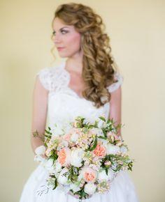 Gorgeous, white & orange bouquet // Theo Milo Photography // http://blog.theknot.com/2013/10/28/a-rustic-meets-regal-wedding-with-cowboy-boot-decor/